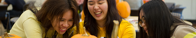 Student having fun decorating pumpkins