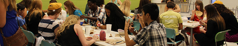 Students making art and meeting people in Paper & Clay